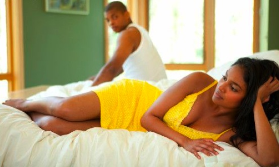 black-couple-laying-on-bed